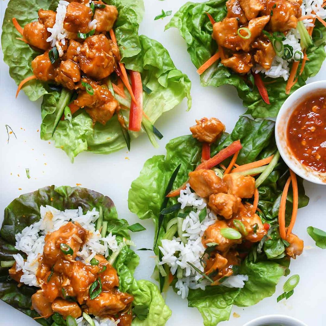 This better-than-P.F. Chang chile-flavored orange chicken lettuce wrap recipe is…